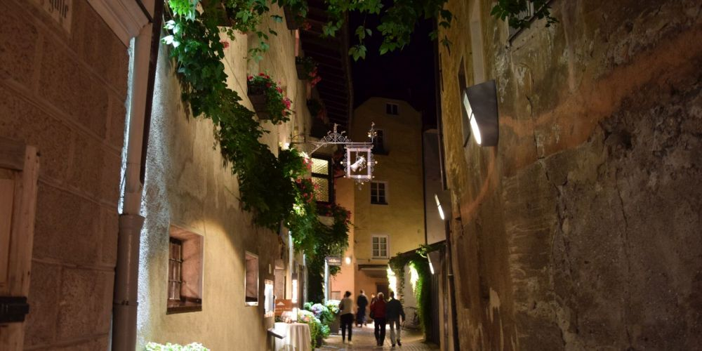 The narrow streets of Brixen look quite picturesque at night.