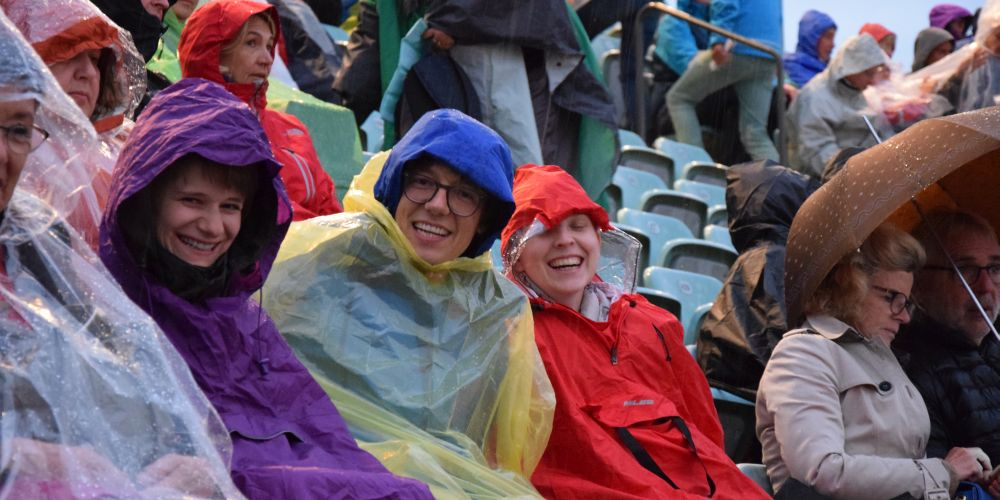 Despite the rain, Kathrin, Daniel and Anna look very happy.